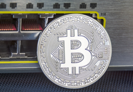 Enlighted metal bitcoin on ethernet ports background