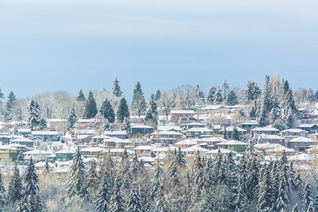 Suburban in the snow. Residential houses in snow on bright winter day in Canada