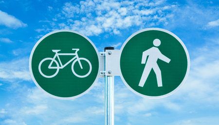 Bicycle and pedestrian shared route sign on cloudy sky background 스톡 콘텐츠