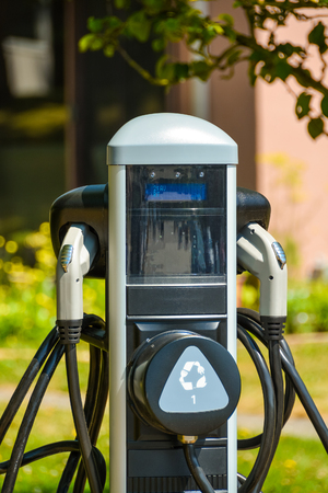 EV charger on bright sunny day. EV - electric vehicle charging station. Electric car charging point. Stockfoto