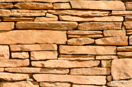 Sand colored stone setting. Stone wall texture Stock Photo