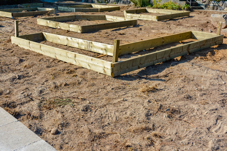 Laying out of garden beds on front yard Archivio Fotografico