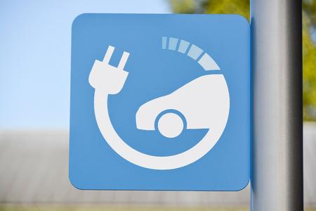 EV - electric vehicle charging station sign on a pillar with blue sky background. 480V DC station