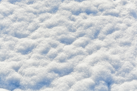 White crystals of snow on flat surface. Texture background Stock Photo