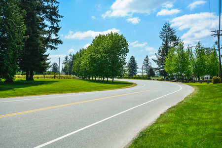 Turn of asphalt road in rural area of Fraser Valley in British Columbia