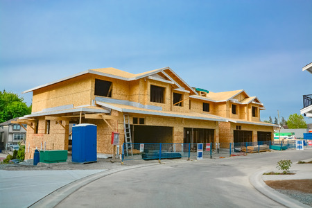 Residential fourplex house under construction. Family townhouse for sale