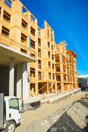 Brand new low-rise building under construction on sunny day in British Columbia, Canada Zdjęcie Seryjne