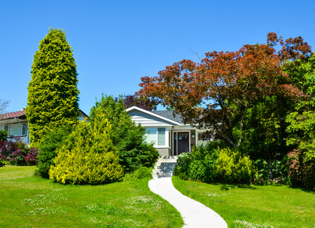 Concrete pathway to a family house on a sunny day in Vancouver, Canada Standard-Bild
