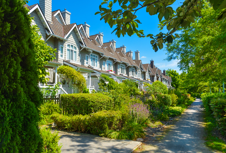 Residential townhouses on sunny day in Vancouver, British Columbia, Canada