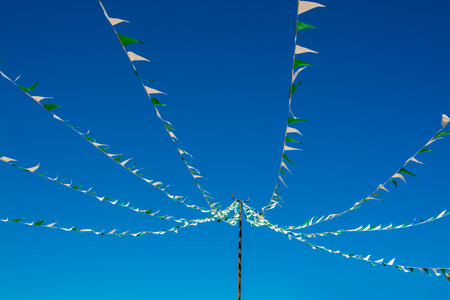 Colorful bunting triangle flags on blue sky background