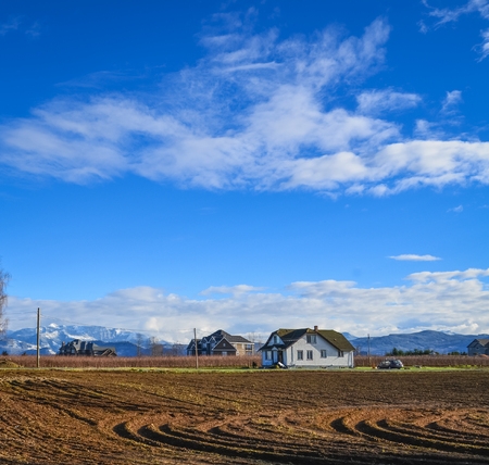 Farmers houses in the middle of the field on winter season in British Columbia