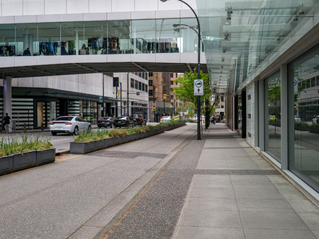 Pedestrian pavement, bike track, and car road in downtown of Vancouver, Canada