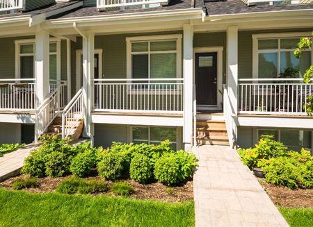 Concrete pathway to the entrance of brand new townhouse on sunny day in Canada Stock fotó