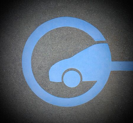 EV - electric vehicle quick charging station sign on asphalt. DC charging. Dark corners