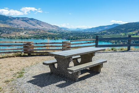 Concrete table with benches on picnic area with great view on Kalamaka lake