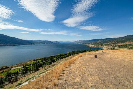 Magnificent view over Okanagan lake and valley with bizarre clouds in the sky