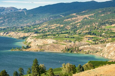 Magnificent view over Okanagan lake inlet with farms on the shore
