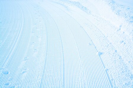 Stripes on snow surface profiled for future ski trace.