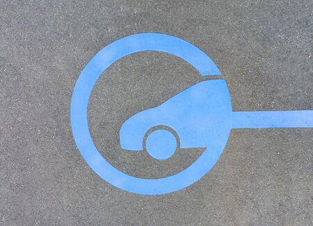 EV - electric vehicle quick charging station sign on asphalt