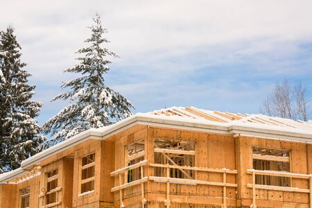 Fragment of townhome complex under construction on winter time