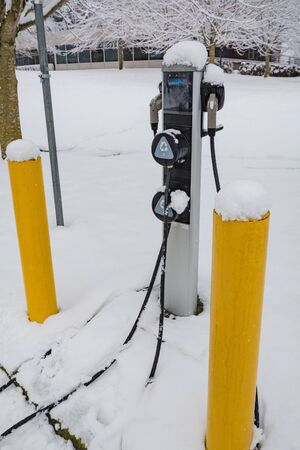 EV charging station for zero emission cars on white snow background Stockfoto