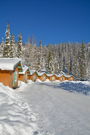 Row of houses in snow in Manning Park, BC.