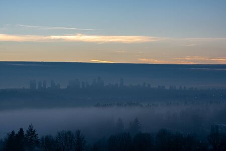 Clear sky background above Metrotown covered with thick fog