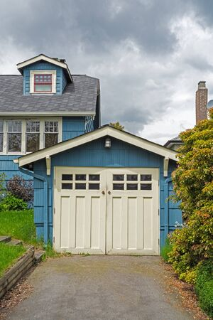 Detached single stall garage on front yard of residential house
