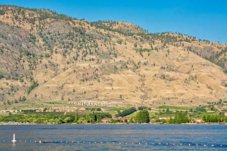 Swimming area of Okanagan lake view with mountain on the background