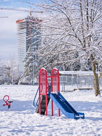 Children's playground in snow on winter season