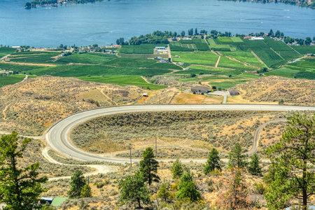 C-shape road in Okanagan valley on summer day 版權商用圖片