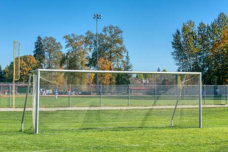 Empty football gate on blue sky background