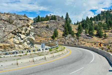 Tight turn on mountain road in Okanagan valley, British Columbia.