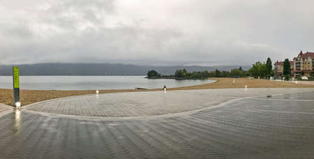 Panoramic view of the beach in Kelowna on overcast rainy day