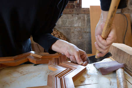 woman carpenter working with wood by hand Stock Photo