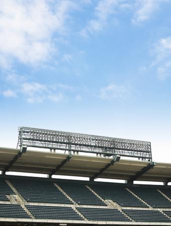 aisles: Empty stadium on a blue sky.