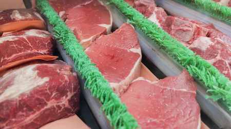 Rows of fresh raw meat on market Stock Photo