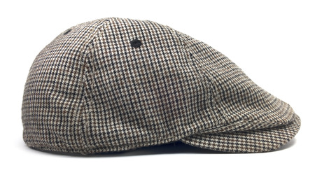 newsboy cap: Isolated newsboy cap. Retro wool driver cap on a white background.