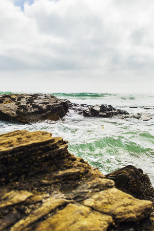 Rocks overlooking beach shoreline.
