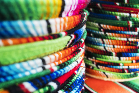 Stacked Mexican sombreros at a street market