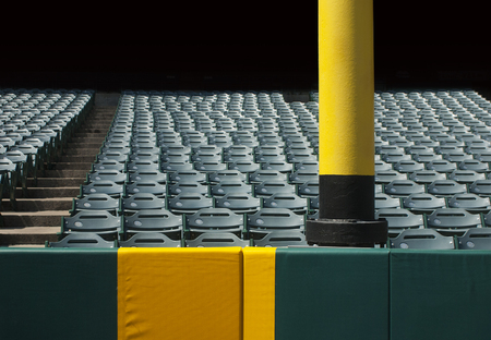 outfield: Baseball foul pole with stadium seats