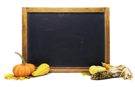 Autumn themed blackboard with pumpkins, corn and squash