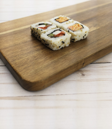 Sushi rolls with crab and avocado on wood. Фото со стока