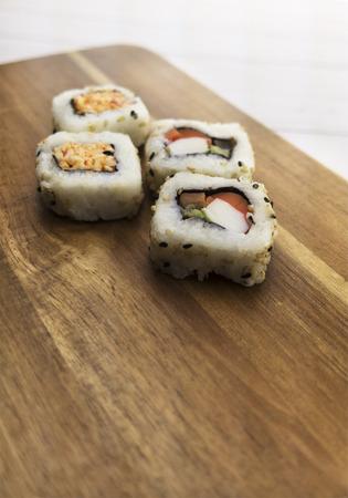Sushi rolls on a wood background. Banco de Imagens