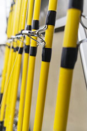 Row Of Fishing Rods On A Fisherman Boat Foto de archivo - 120934378