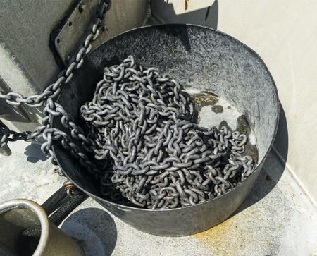 Boat anchor chain in large metal bin