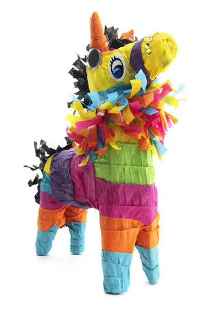 Festive Mexican donkey piñata with yellow gemstones on a white background. Banco de Imagens