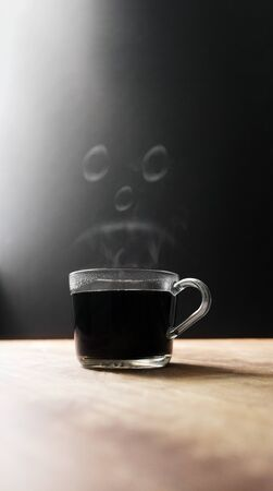 Hot Coffee Cup With Steamy Sad Face Foto de archivo - 131815216