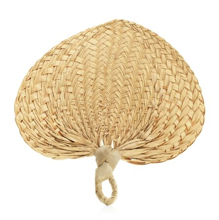Isolated woven straw fan on a white background.