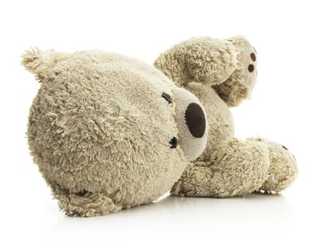 Isolated Teddy Bear Laying on Side Foto de archivo - 131813007